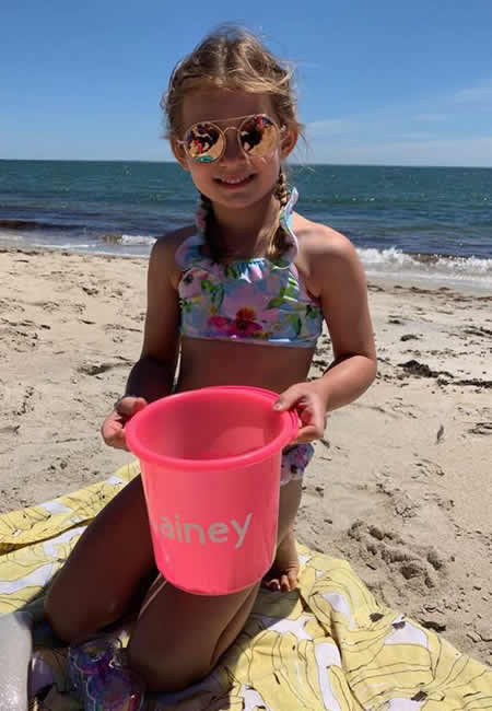 Girls bathing suits, sunglasses and personalized sand pails at folia in south dartmouth, ma